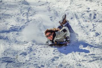 USA, Pennsylvania, Montgomery County, Abington Township, Moredon Road, Lorimer Park, Mature woman having fun on sled