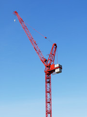 Red crane against clear sky