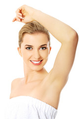 Spa woman showing her shaved armpit.