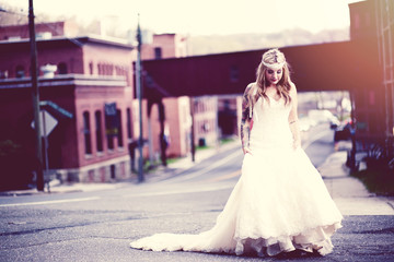 Bride walking down street