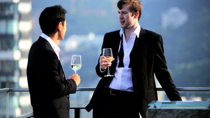 Young Multi Ethnic Businessmen Outdoors Rooftop Bar