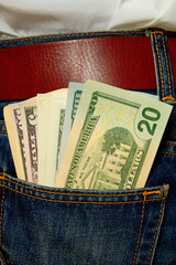 Dollars in jeans pocket.