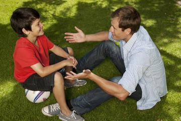 Man Talking To Boy
