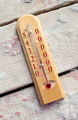 Room wooden thermometer on boards with cement