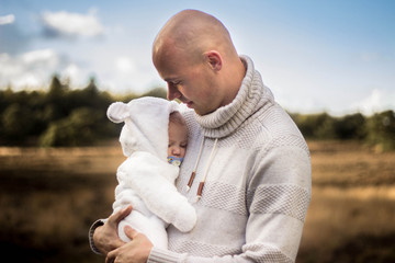 Netherlands, Father holding newborn child