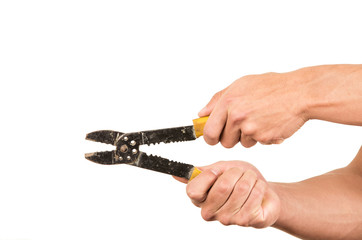 closeup of hand holding pliers