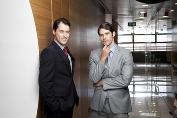 Two businessmen in office corridor
