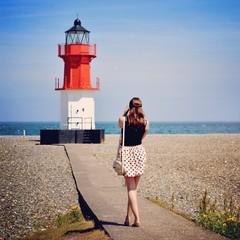Woman shooting lighthouse