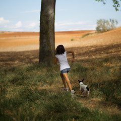 Spain, Madrid, Girl running with dog