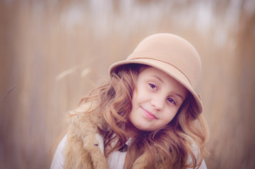 Portrait of girl in beige hat