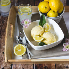 Tray of lemon fruit, ice cream and lemonade