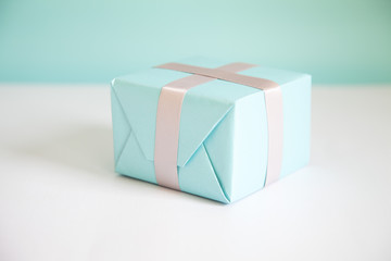 Gift box wrapped in blue paper
