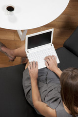 Elevated view of woman using laptop