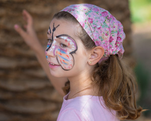 Spain, Valencia, Girl (6-7) with face painted