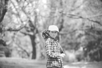 Portrait of boy (8-9) in park