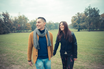 young couple in the park during autumn season outdoor