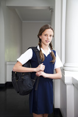 Teenage girl in school building