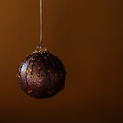 Decoration ball against brown background