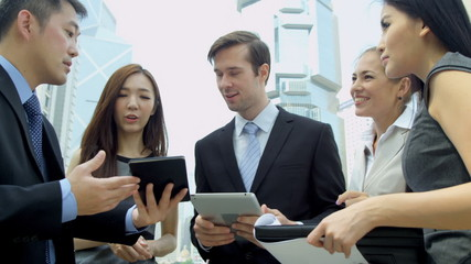 Asian Chinese Caucasian Business Team Tablet Technology