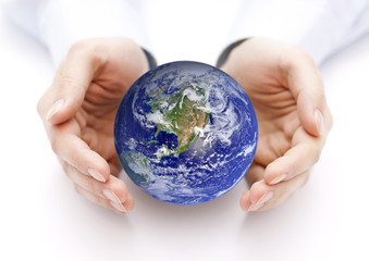 Earth in hands. Earth image provided by Nasa.