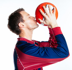 Footballer kissing football