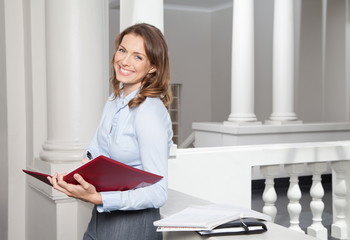Businesswoman Writing In File