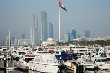 United Arab Emirates, Abu Dhabi, Skyline with harbor and boats in foreground