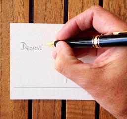 Man writing postcard
