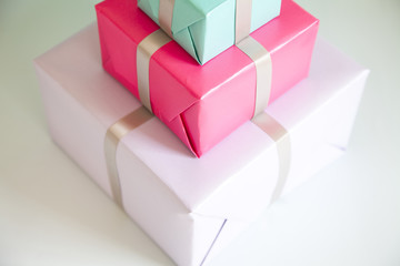 Stack of three wrapped gifts