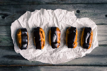 Eclairs on rustic background