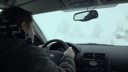 Side shot of driving in the snow