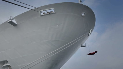 Low angle shot of white cruiser's bow