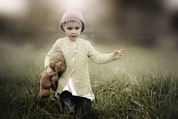 Girl holding teddy while running