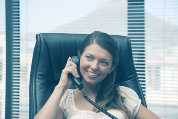 Woman in office using phone