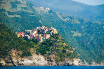 Italy, Liguria, Cinque Terre, Corniglia, Multi colored town architecture among hills
