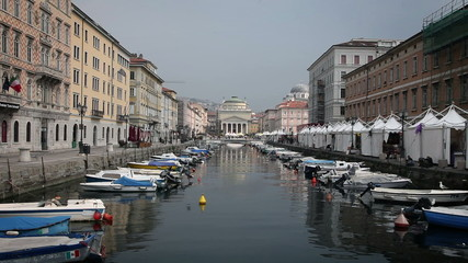 Shot of the sea canal in Trieste, full of parked boats
