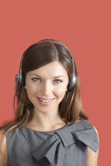 Portrait of smiling woman wearing headset