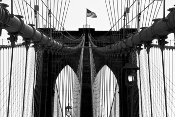 USA, New York City, Manhattan, Close up of Brooklyn Bridge with flag