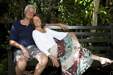 South Africa, Senior couple sitting on garden bench
