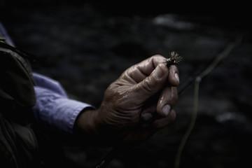 USA, Colorado, Hinsdale County, Lake City, Angler holding fishing tackle fly