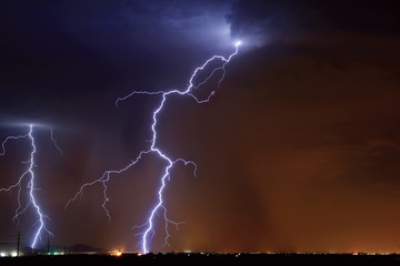 USA, Arizona, Maricopa County, Hassayampa, Lightning striking in farming area near little town