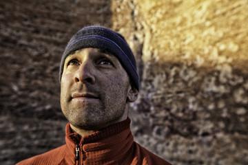 USA, Colorado, Portrait of rock climber looking up