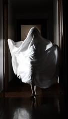 Boy (12-13) dressed as ghost