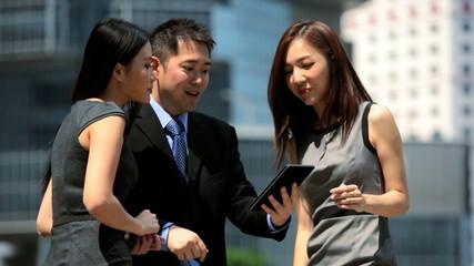 Ethnic Business Team Outside Modern City Buildings