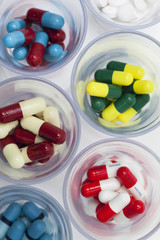 cups with multicoloured pills