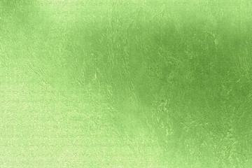 Green luminous background, linen texture, festive backdrop