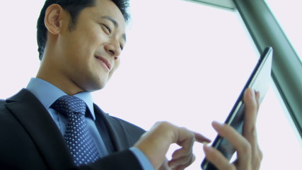 Male Asian Chinese Stock Broker Tablet Close Up