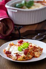 Lasagna rolls with tomato sauce