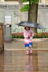 Girl (2-3) holding umbrella