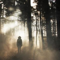 Hooded figure in woods
